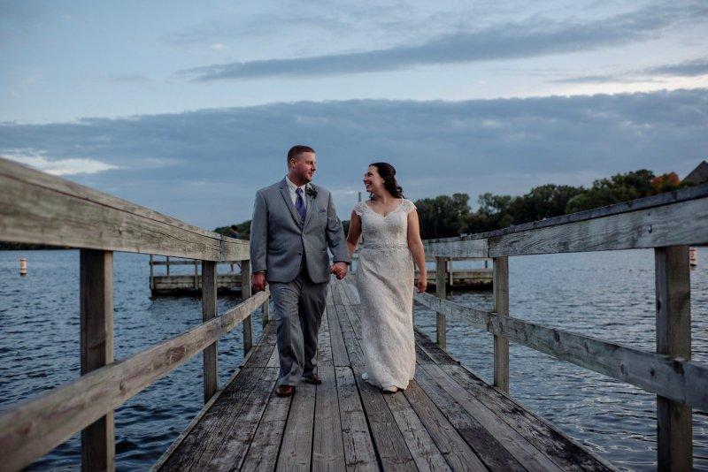 Wedding couple on dock at Bryant Lake Pavilion, MN