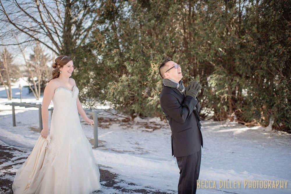 first look in snow Rush Creek Golf Club Winter Wedding MN