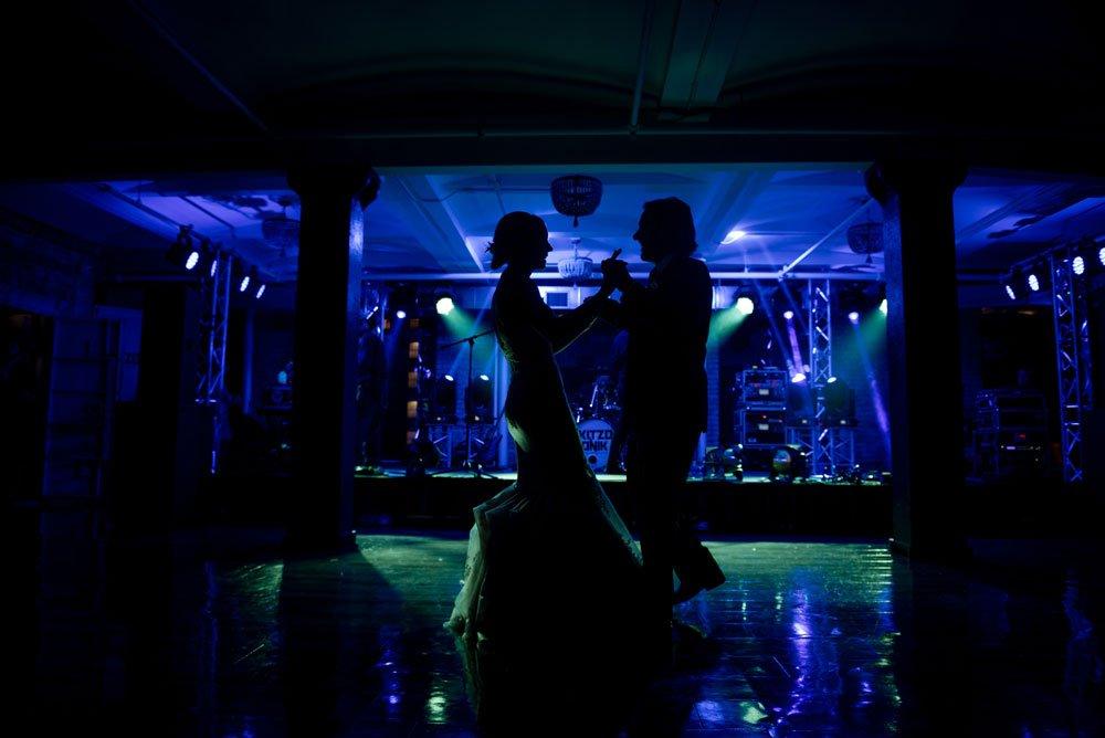 Silhouetted on the dance floor Lumber Exchange Wedding