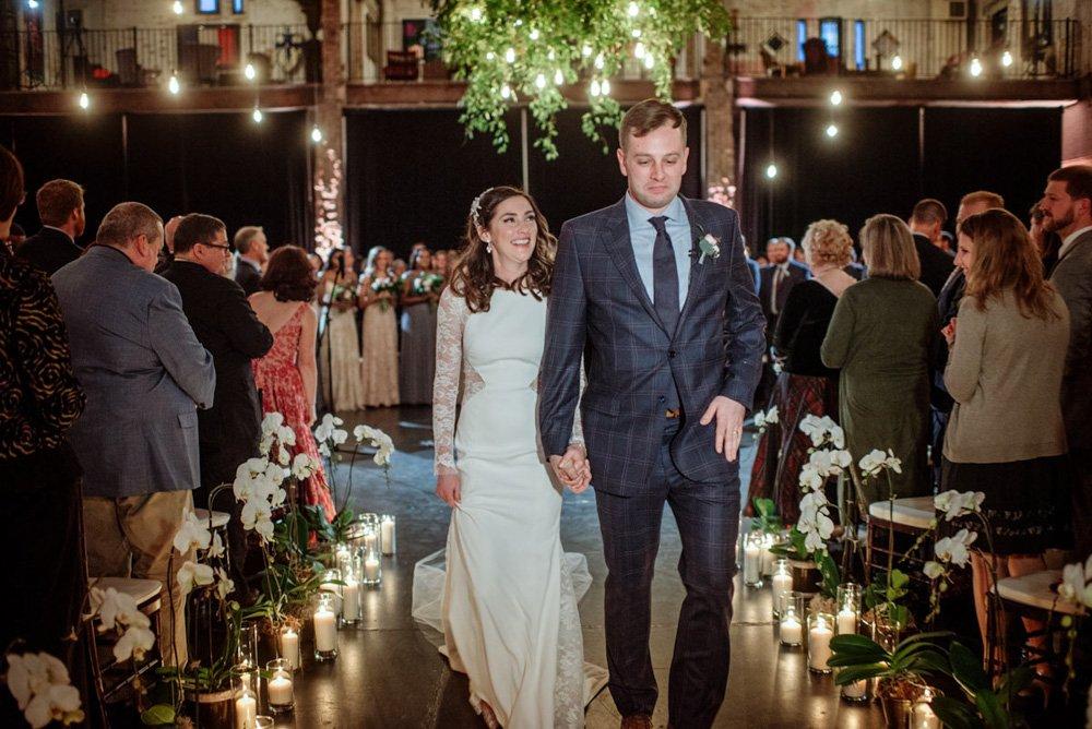 couple walks down aisle married at aria wedding minneapolis