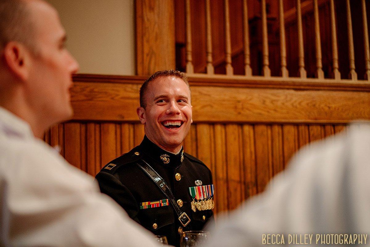 groom laughs with groomsmen in basement of Van Dusen Mansion Wedding Minneapolis