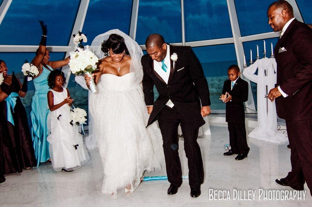 Bride and groom jump the broom