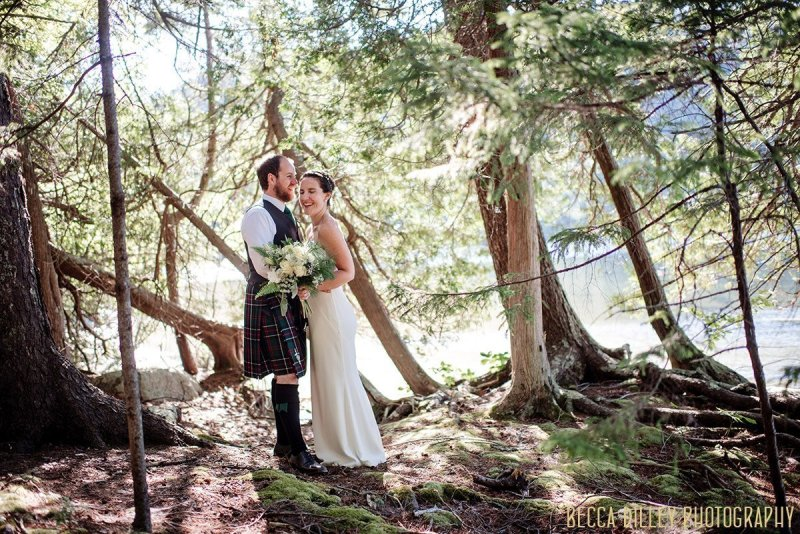 couple in woods destination wedding by Acadia National Park in Maine
