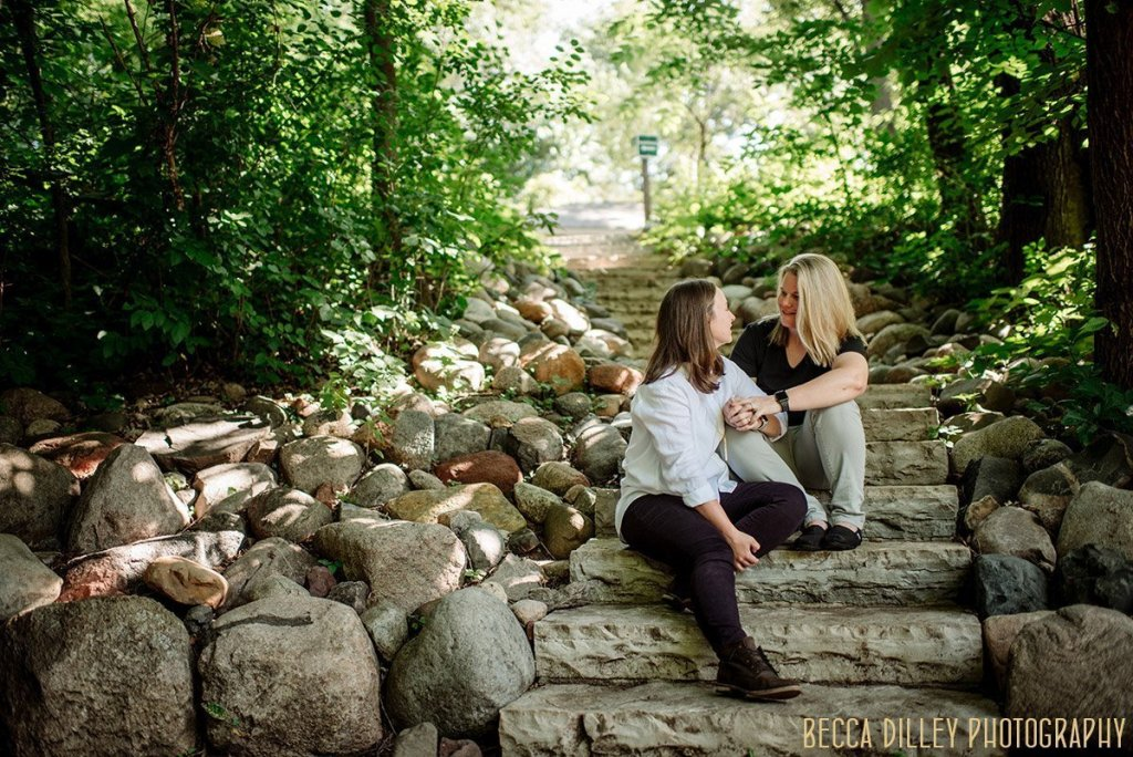 Richardson Nature Center engagement photos two women on stone stairs