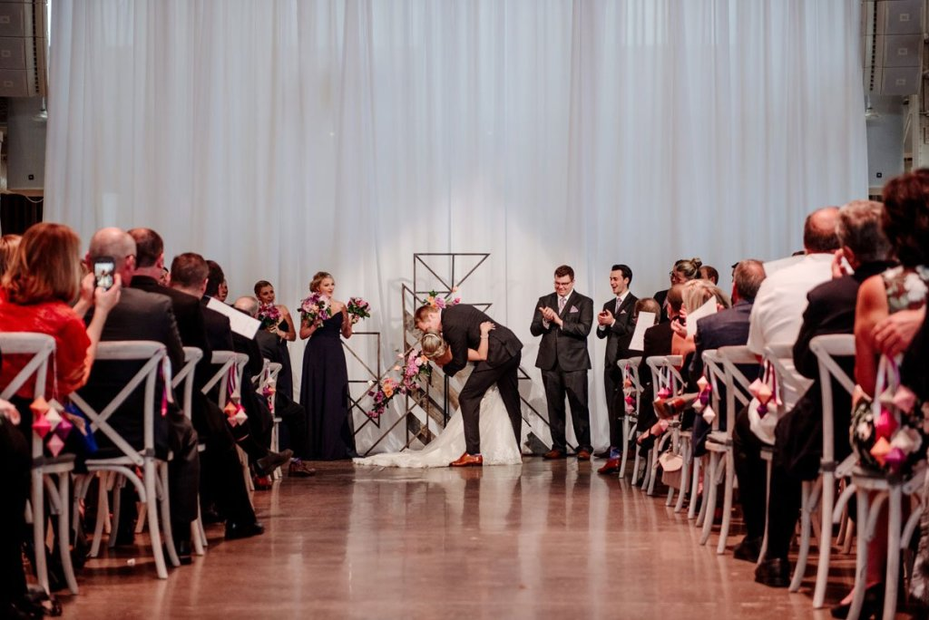 First kiss at Machine shop wedding