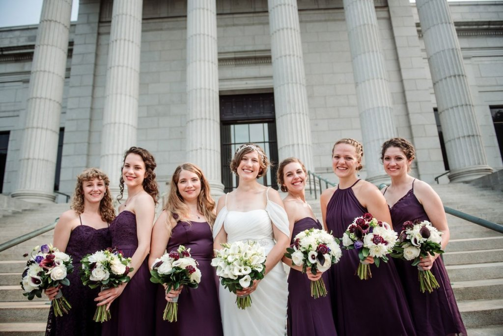 6 bridesmaids and bride on stairs outside Minneapolis Institute of Art