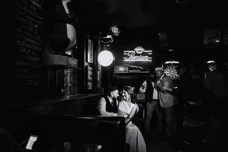 minneapolis dive bar wedding couple in booth at grumpys northeast