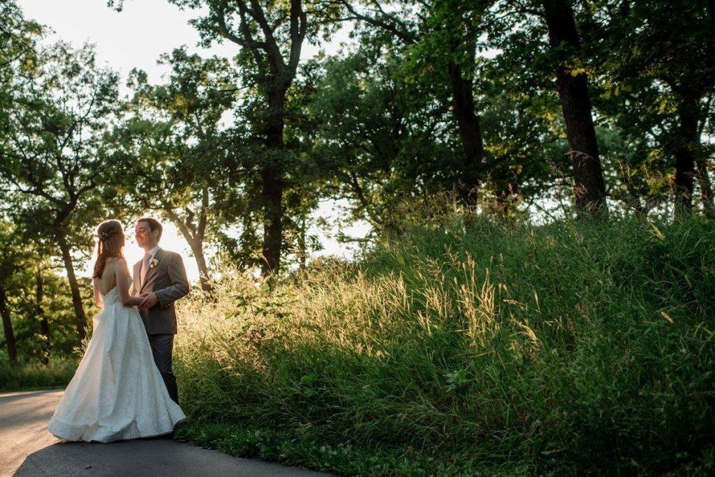 couple dancing in sunlight silverwood park wedding mn