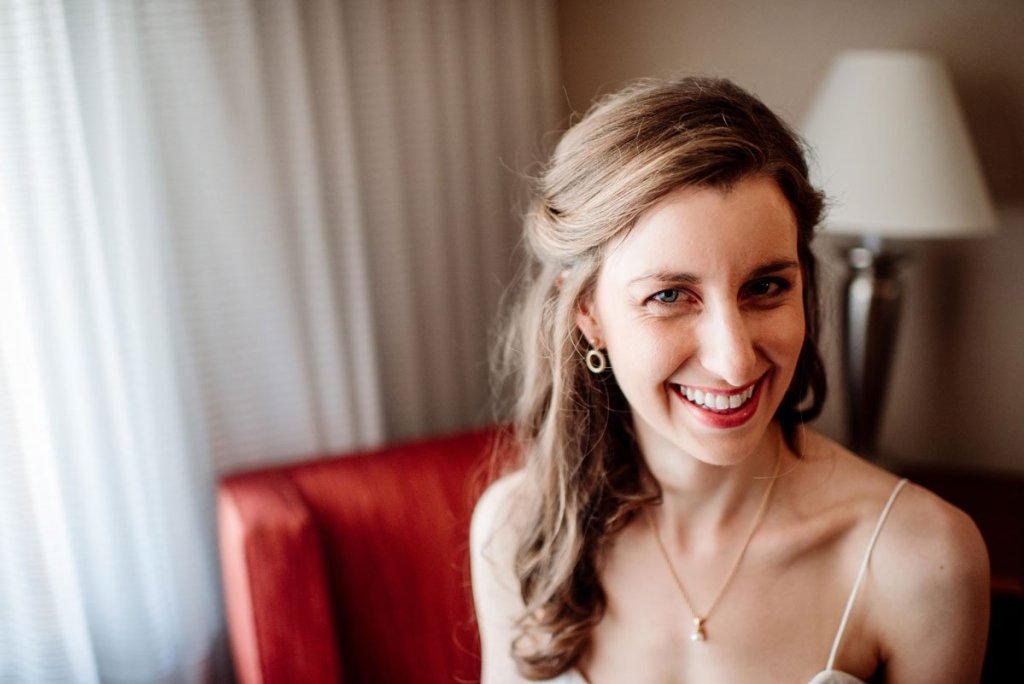bride in hotel room smiling before silverwood park wedding mn