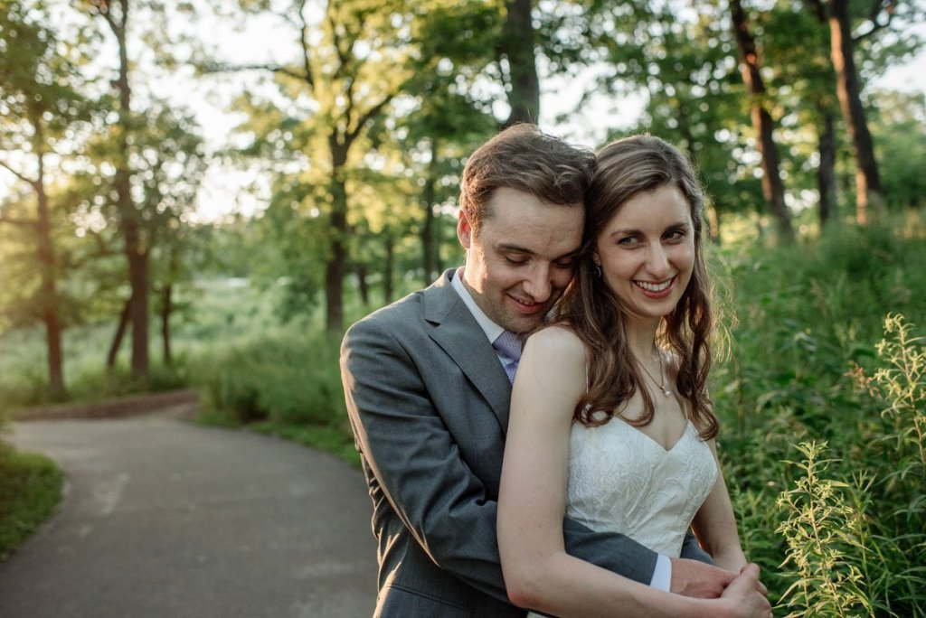 couple laughing in sunlight at silverwood park wedding mn