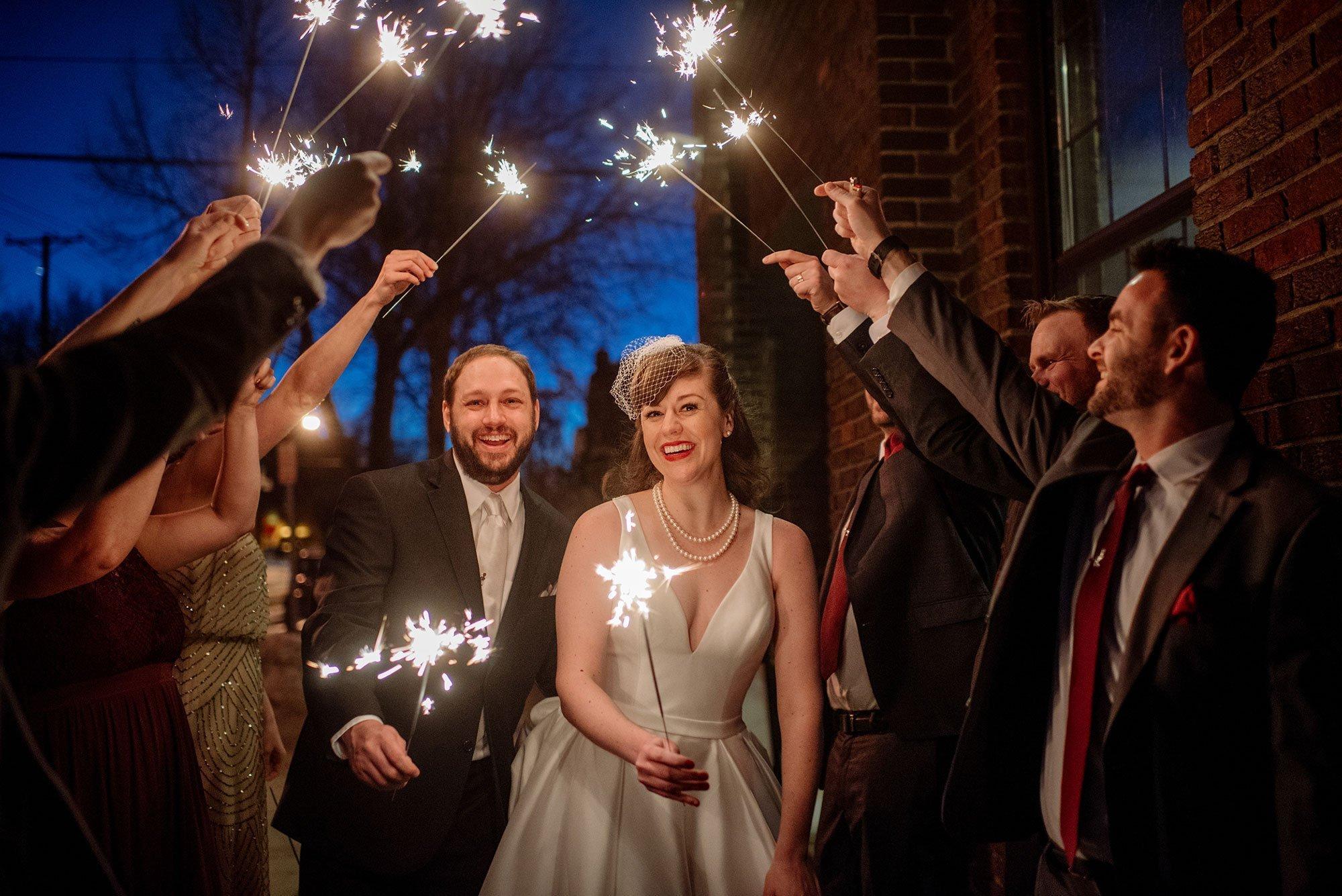 couple under sparklers at solar arts wedding