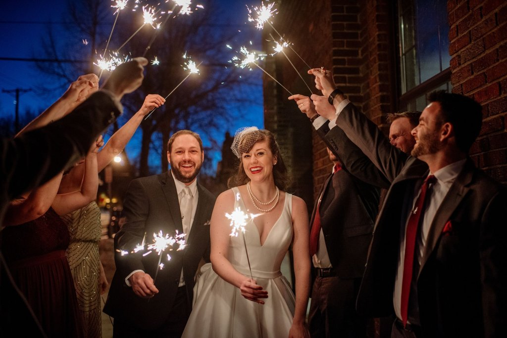 couple under sparklers at solar arts wedding