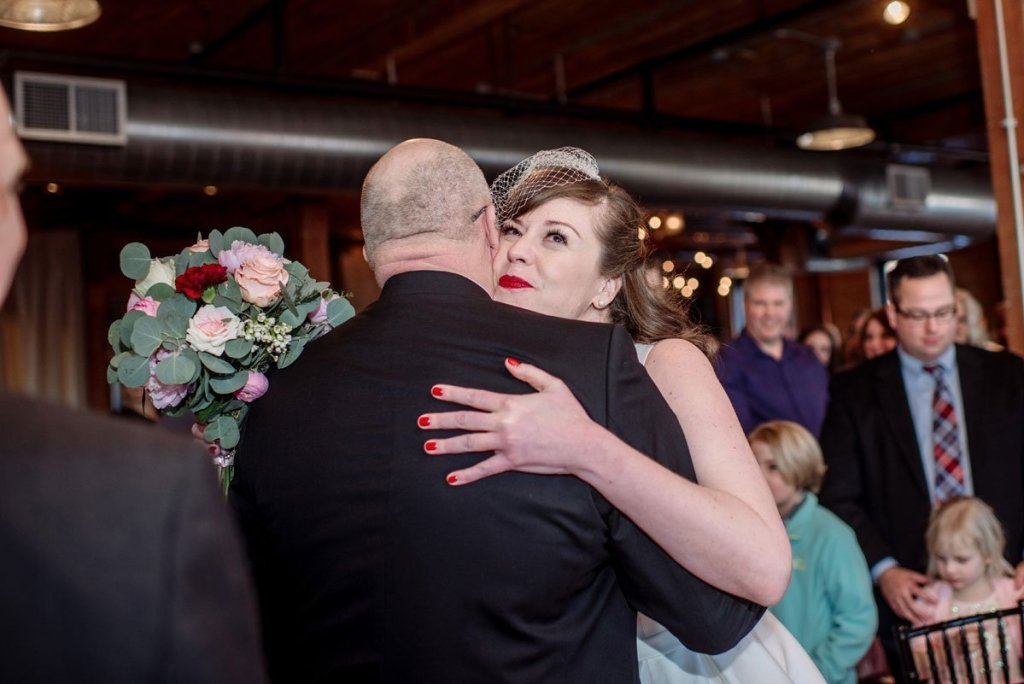 brid hugs dad at beginning for wedding ceremony at solar arts