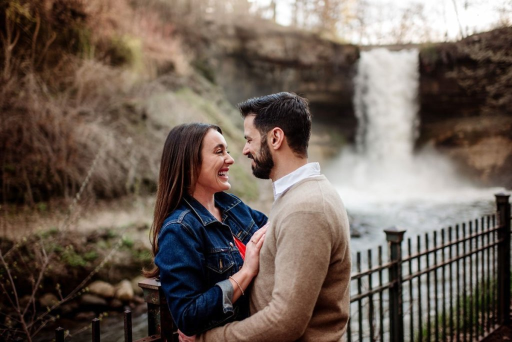 couple by minnehaha falls in minneapolis