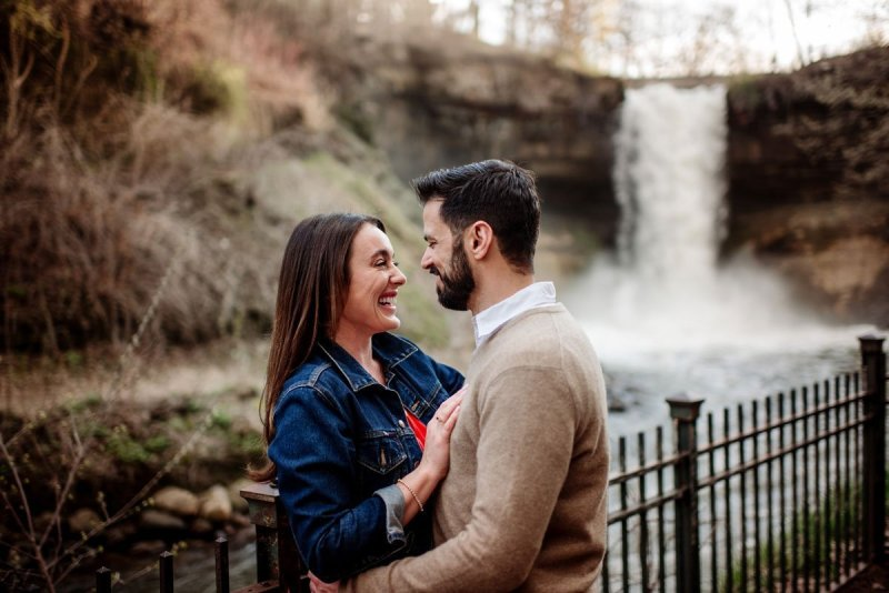couple by minnehaha falls in minneapolis