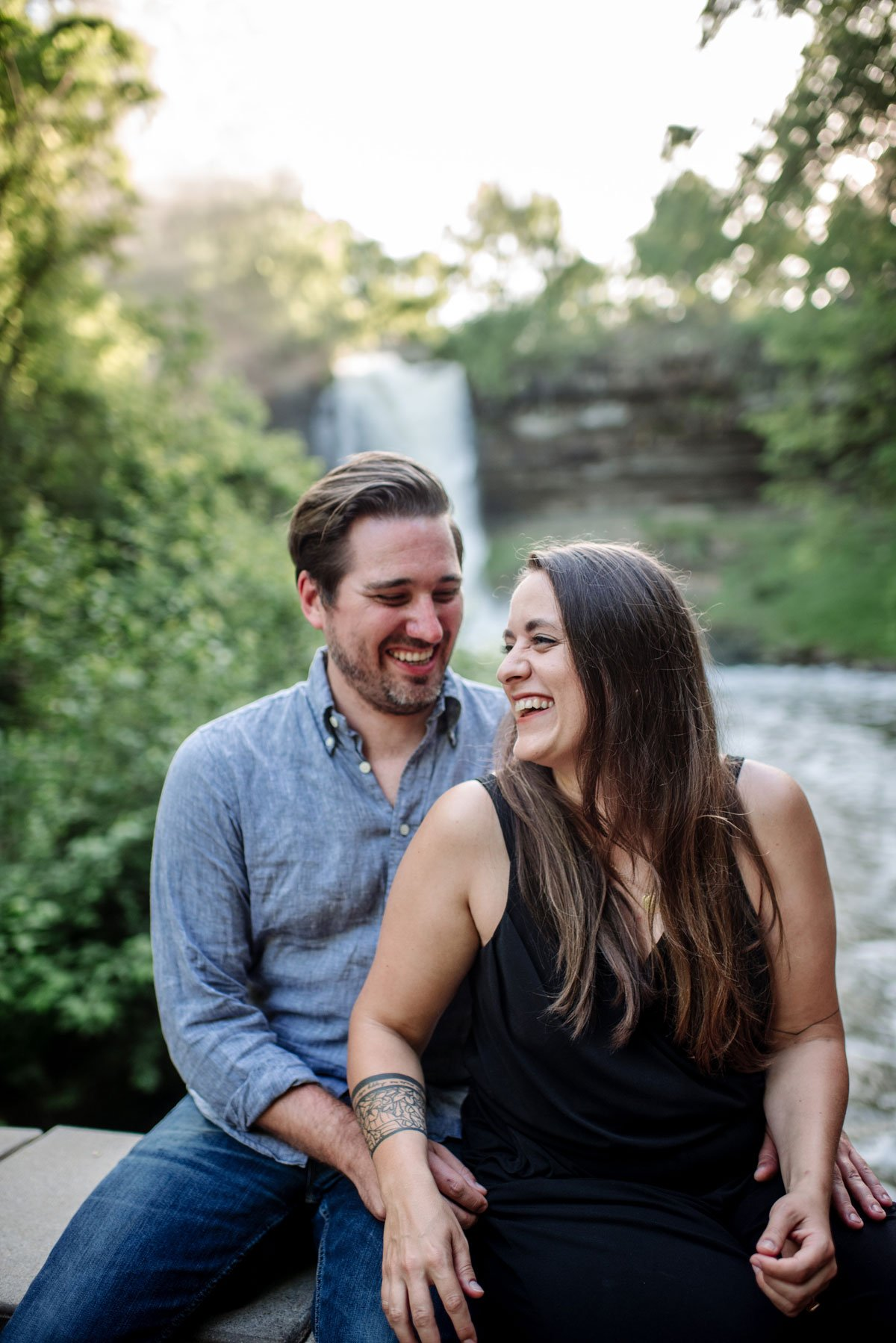 advice about having happy engagement photos featuring portrait of couple at minnehaha falls