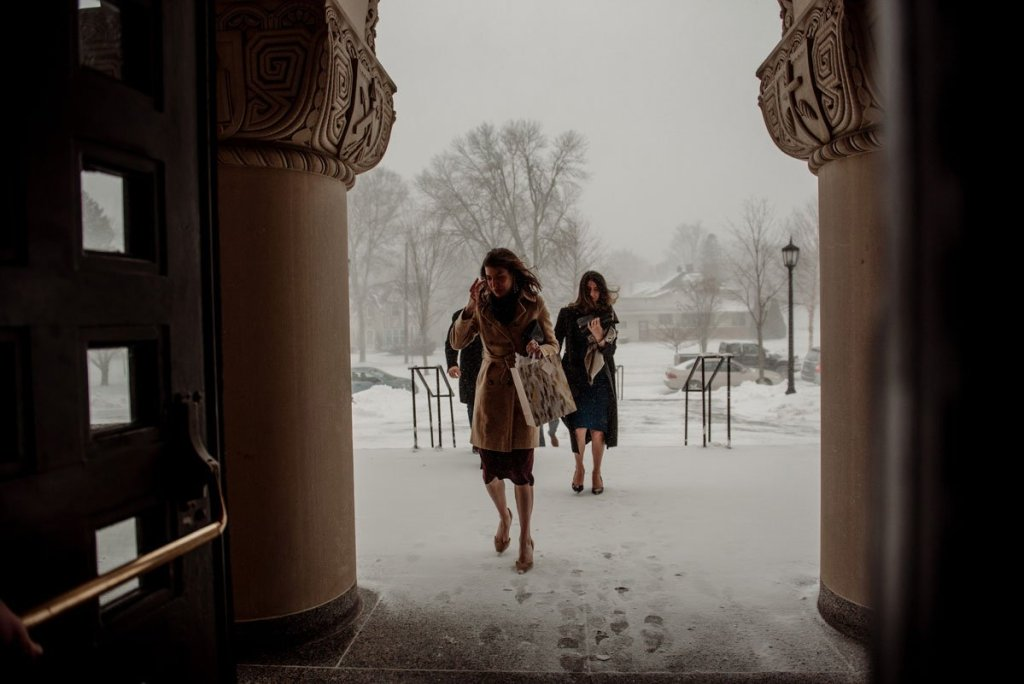 wedding guests covered in jackets trek through snowstorm to mn wedding