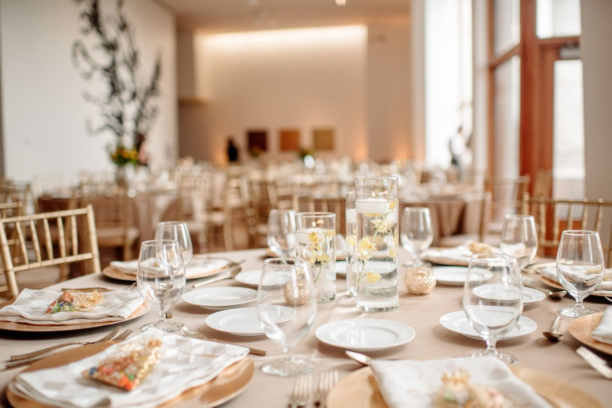gold tablecloth and napkins at Weisman Art Museum for wedding reception