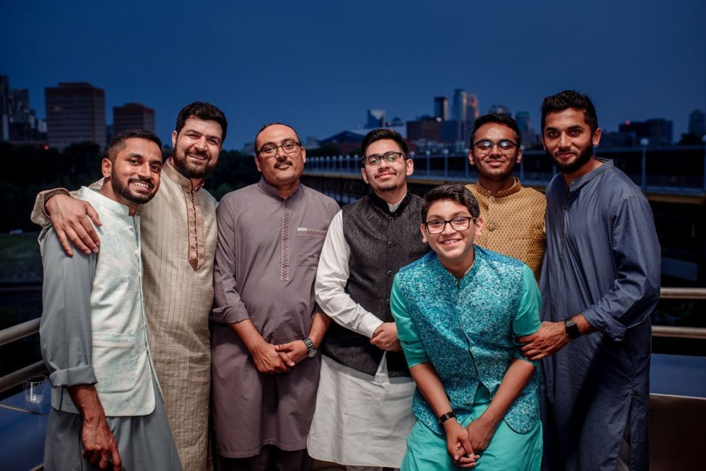 guests gather on the balcony of the Weisman Art Museum for this muslim pakistani wedding