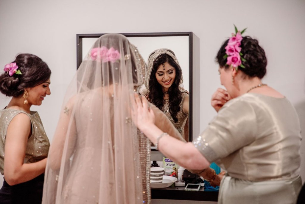 bride and mother adjust sari before wedding in Minneapolis