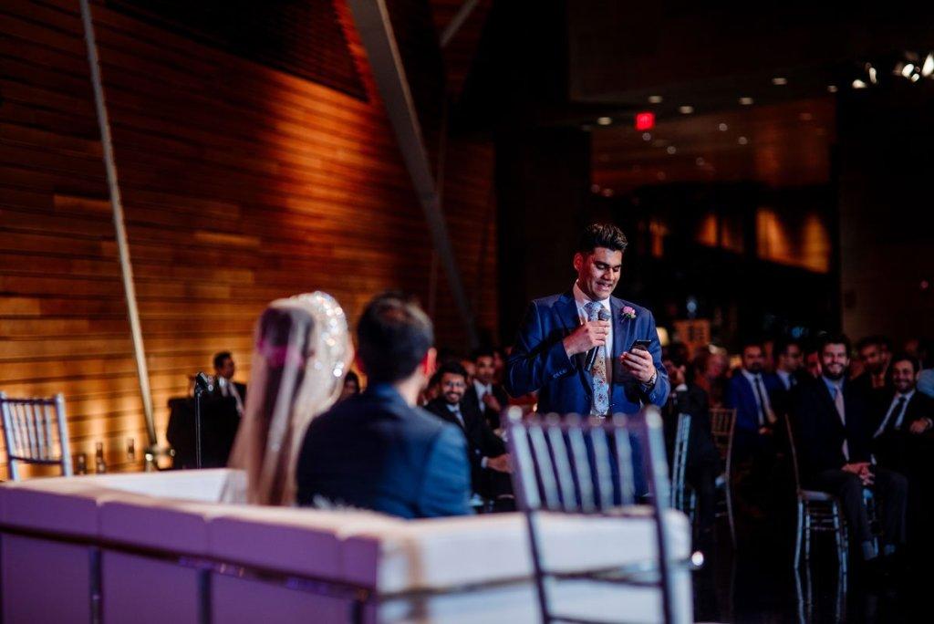 brother of groom gives speech at mulsim pakistani wedding at McNamara Center in Minneapolis