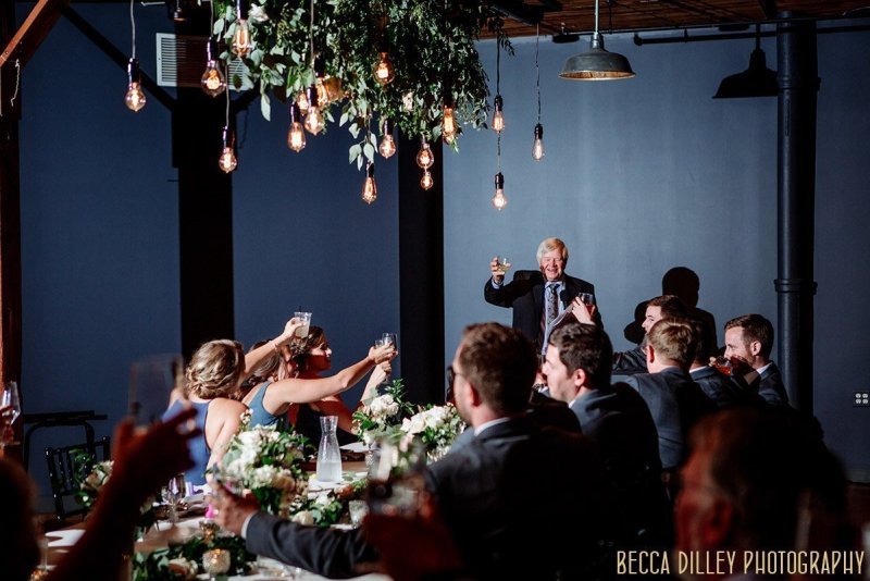 father toasts his daugher on her wedding day at solar arts in Northeast Minneapolis