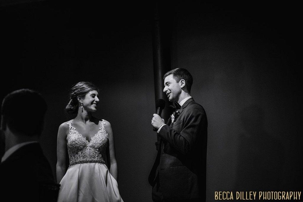 groom toasts his bride at  solar arts wedding reception