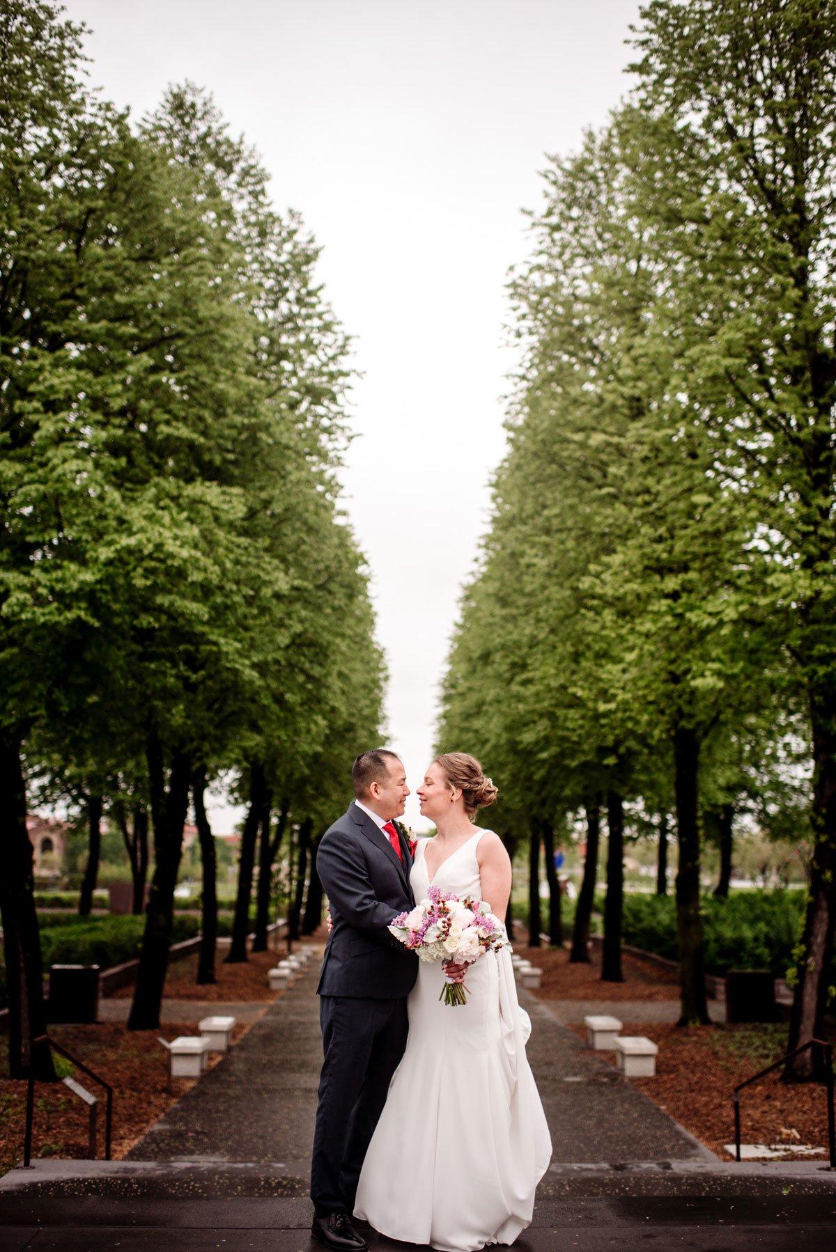 couple by sculpture garden for portraits before walker art center wedding