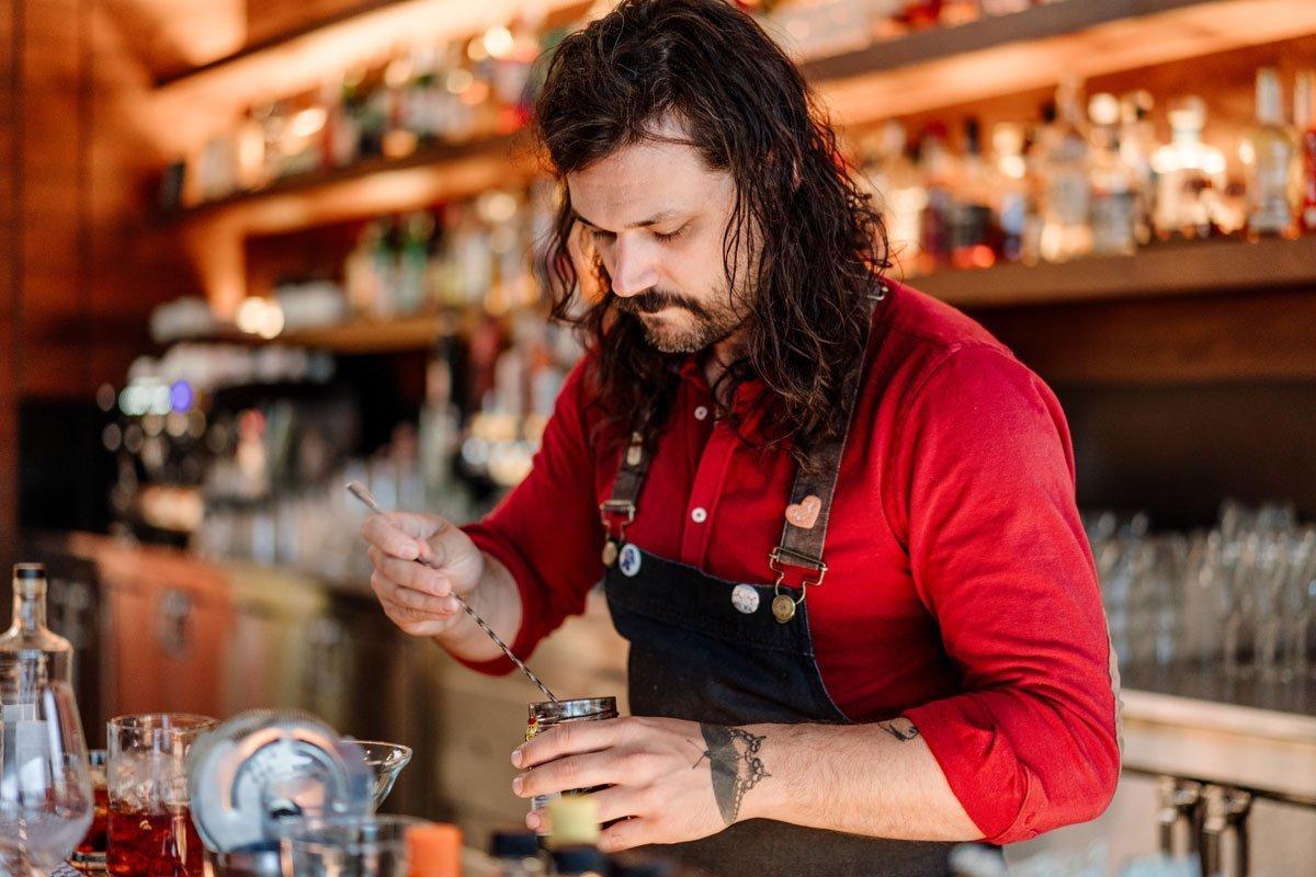 bartender makes craft cocktails esker grove wedding at the walker art center minneapolis
