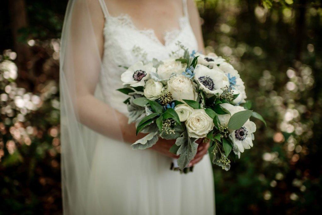 flowers in brides hand voyageur wedding environmental center mn