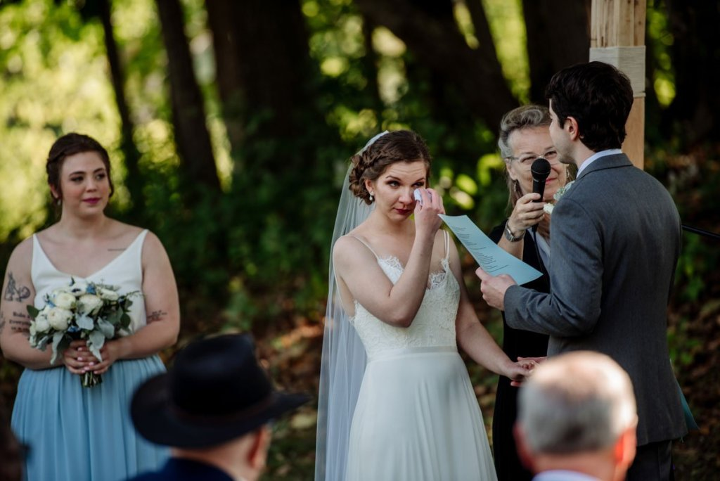 bride cries during wedding ceremony at voyageur in MN