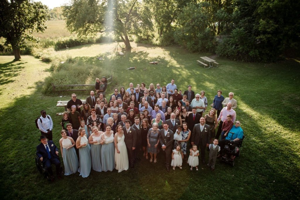 all guests of wedding post for a group portrait voyageur in MN