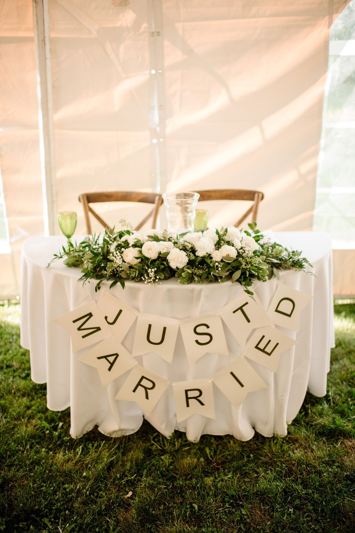 just married on couples table inside tent voyageur wedding environmental center mn