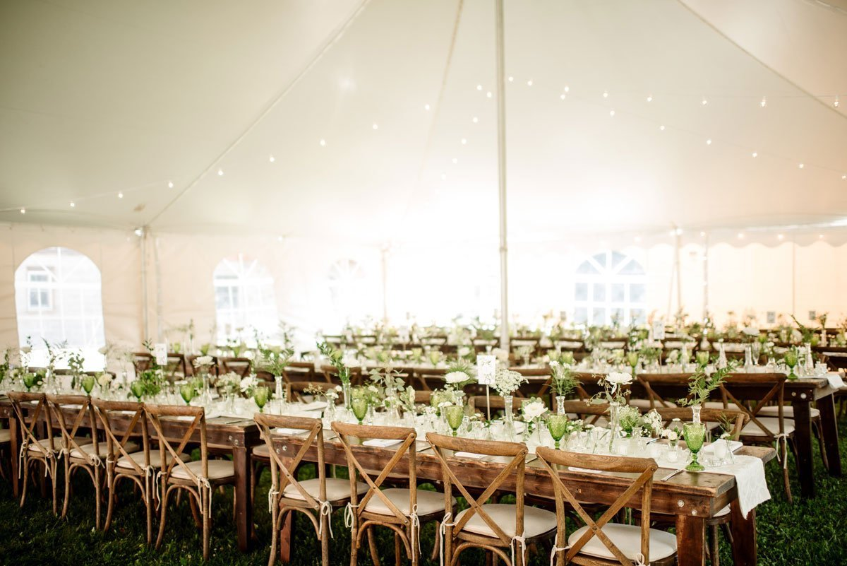 long tables inside tent with decorations voyageur wedding environmental center mn