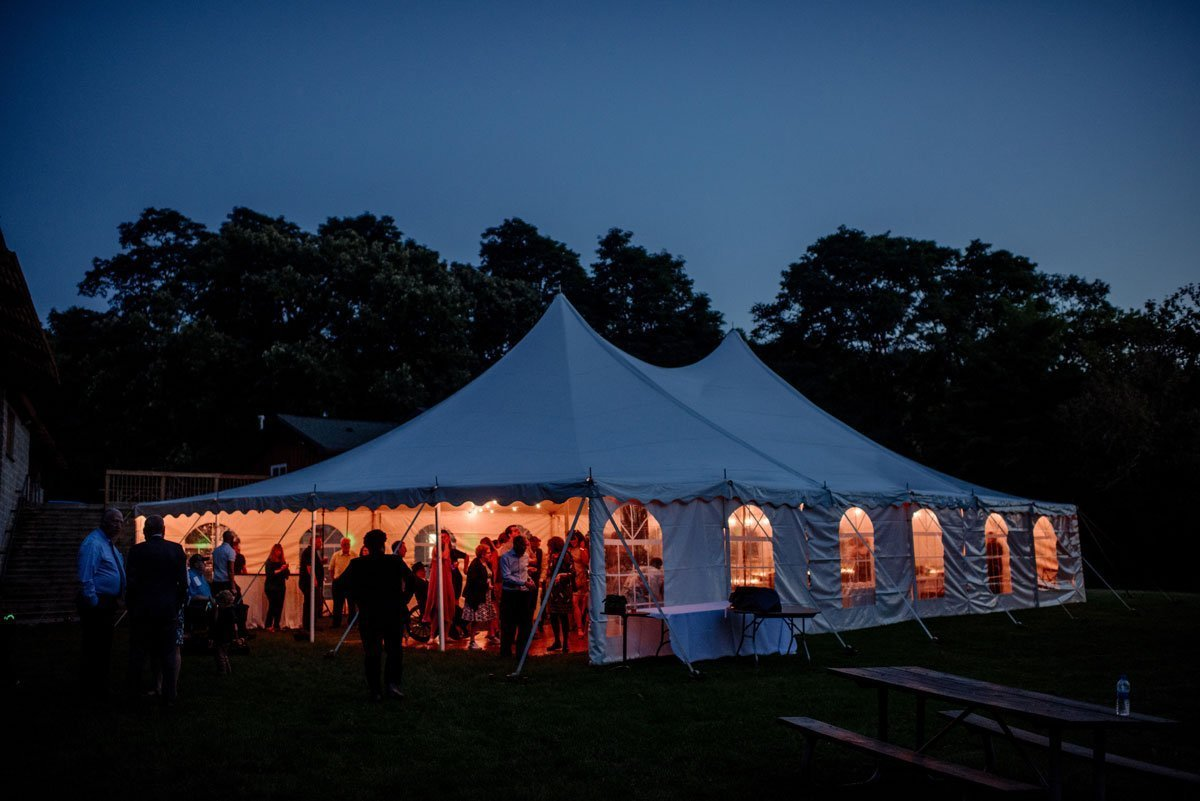 tent at night with dancing voyageur wedding environmental center mn
