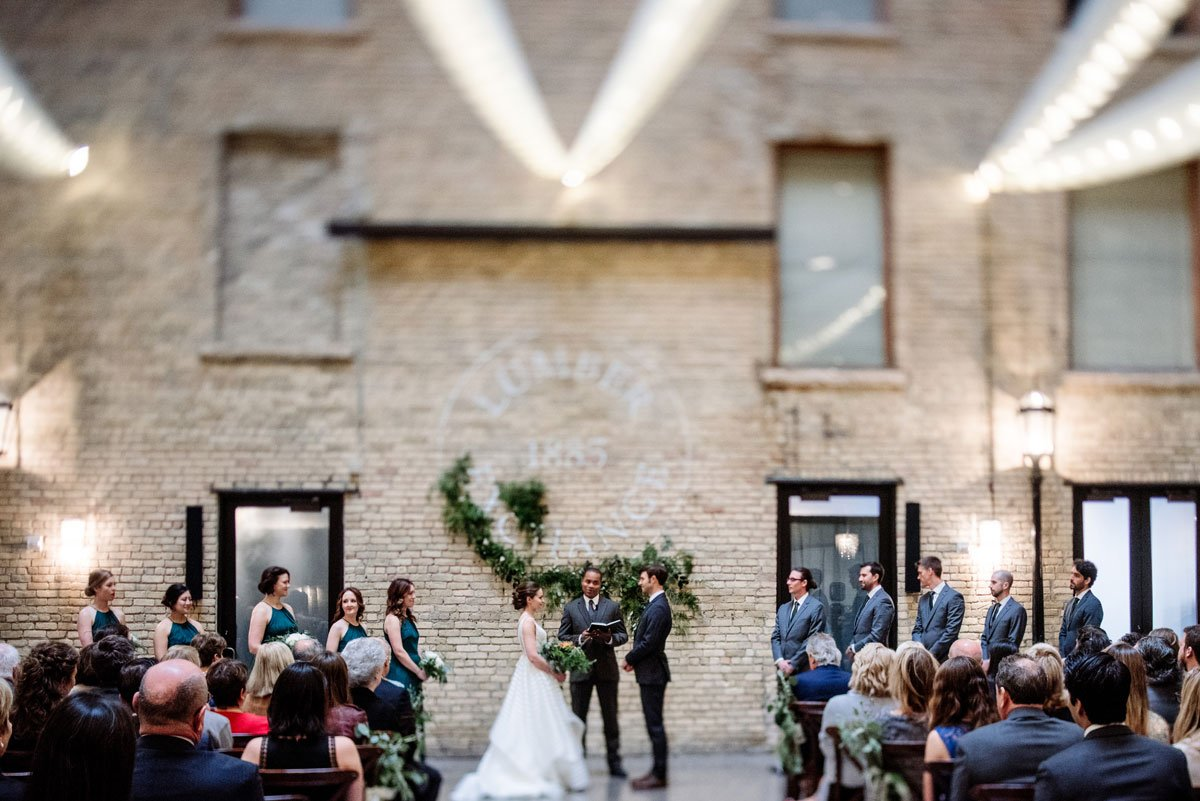 wedding ceremony in lumber exchange minneapolis with tilt shift lens to create soft focus on celiling