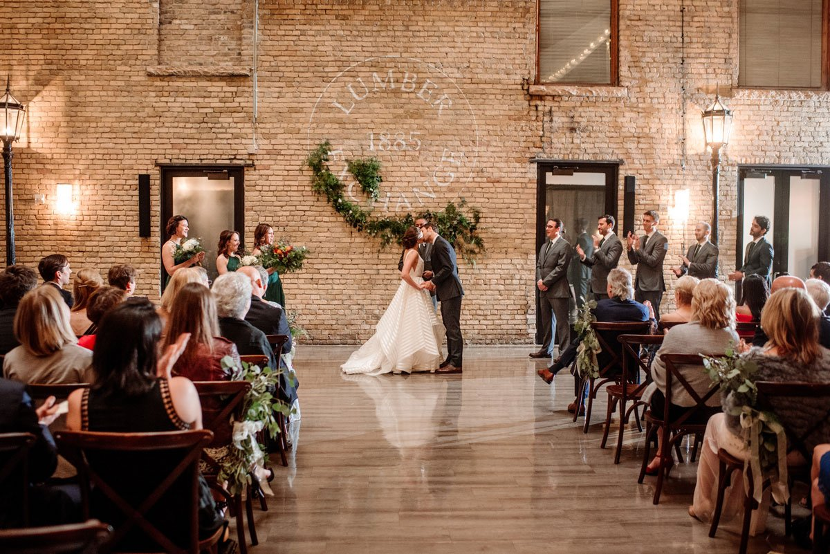 first kiss wedding ceremony at lumber exchange minneapolis