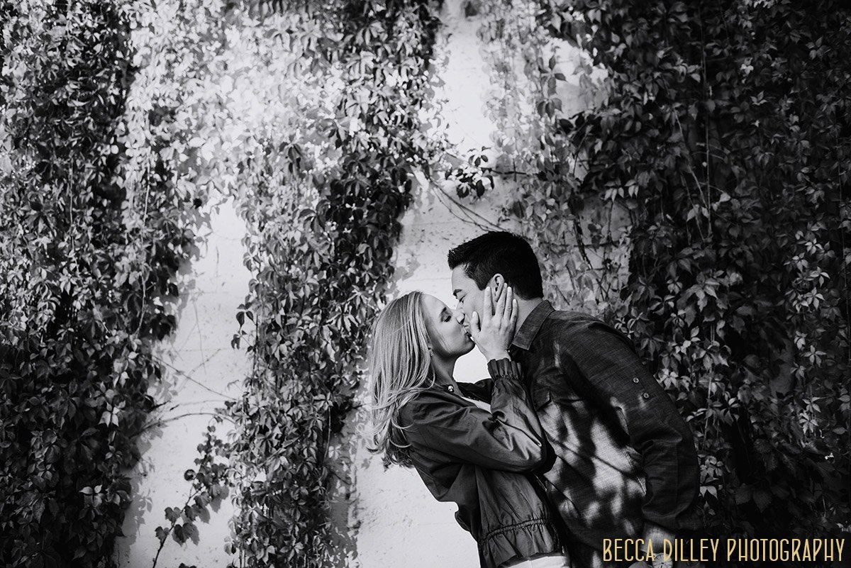 couple kisses by ivy at St Anthony Main, Minneapolis engagement photography