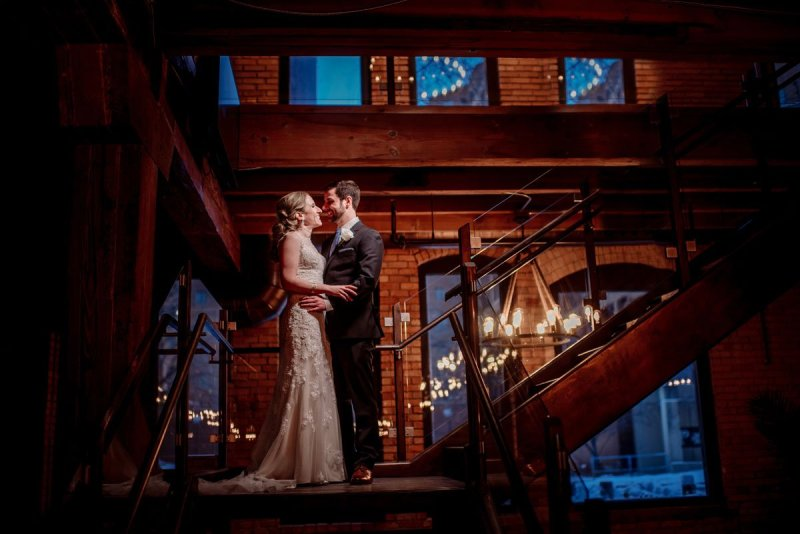 on stairs of Minneapolis event center before new years eve wedding