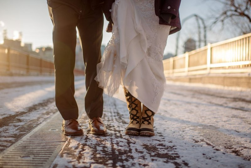 Snowy boots and dress shoes in freezing weather for Minneapolis New Years Eve wedding