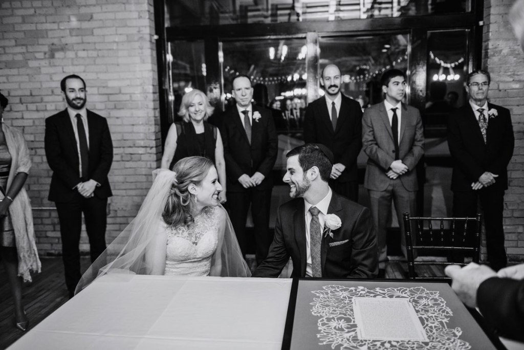 ketubah signing at MInneapolis event center couple look at each other