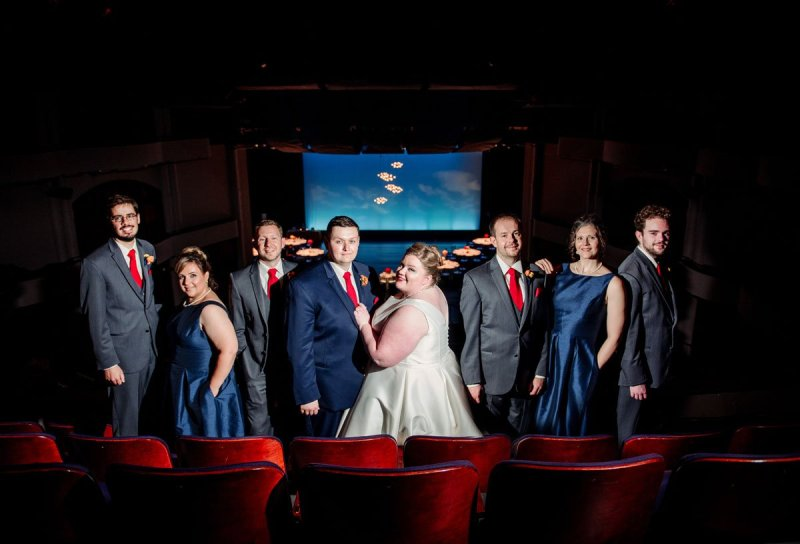 flash composite portrait of wedding party in balcony seating of washington pavilion wedding sioux falls