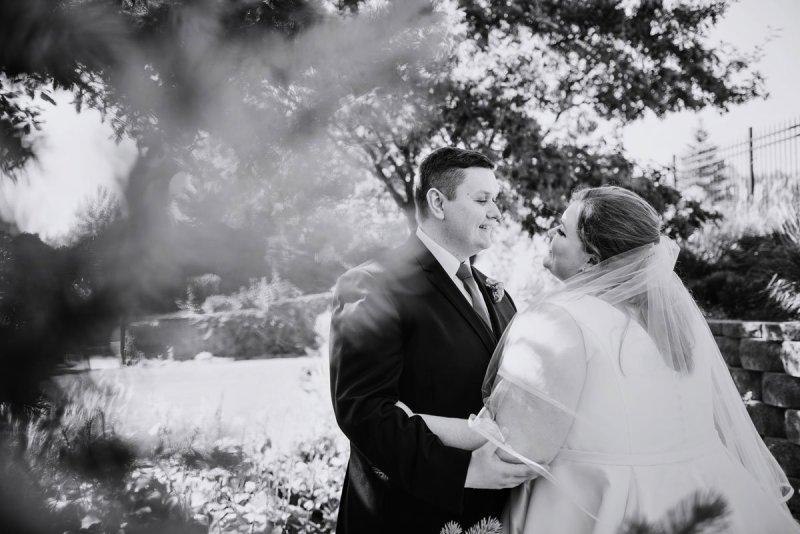 black and white photo of couple under trees washington pavilion wedding sioux falls