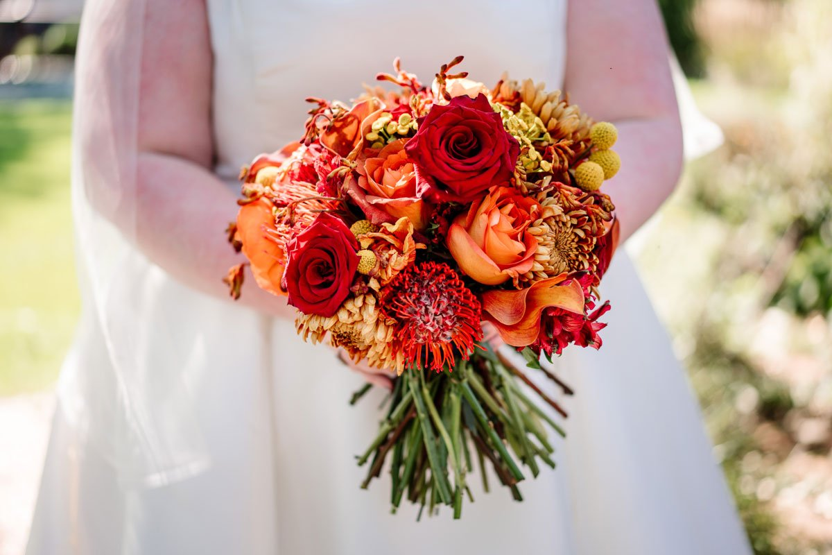 bold red and orange flowers for bride wedding sioux falls