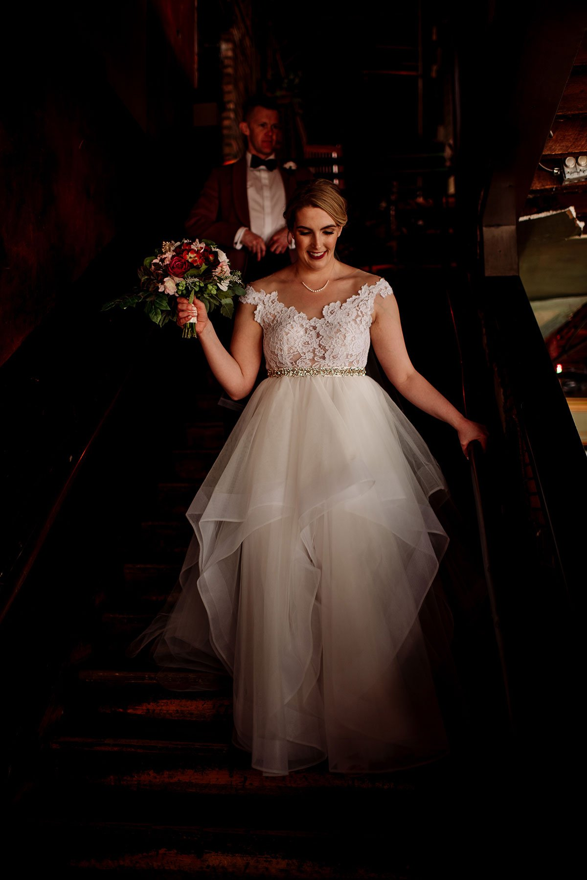 moody portrait of bride walking down stairs at loring restaurant wedding minneapoils