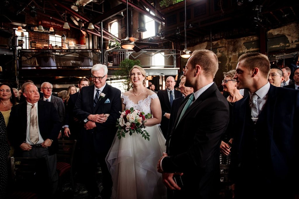 bride and father walk down aisle at loring restaurant wedding minneapolis