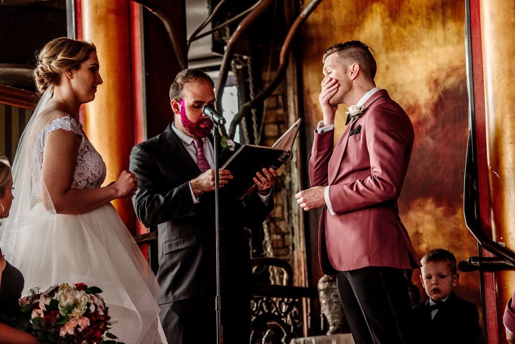 groom excited during wedding vows at loring restaurant wedding minneapolis