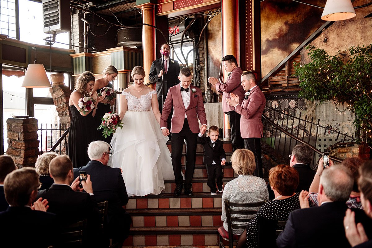bride and groom walk down aisle loring restaurant wedding minneapolis