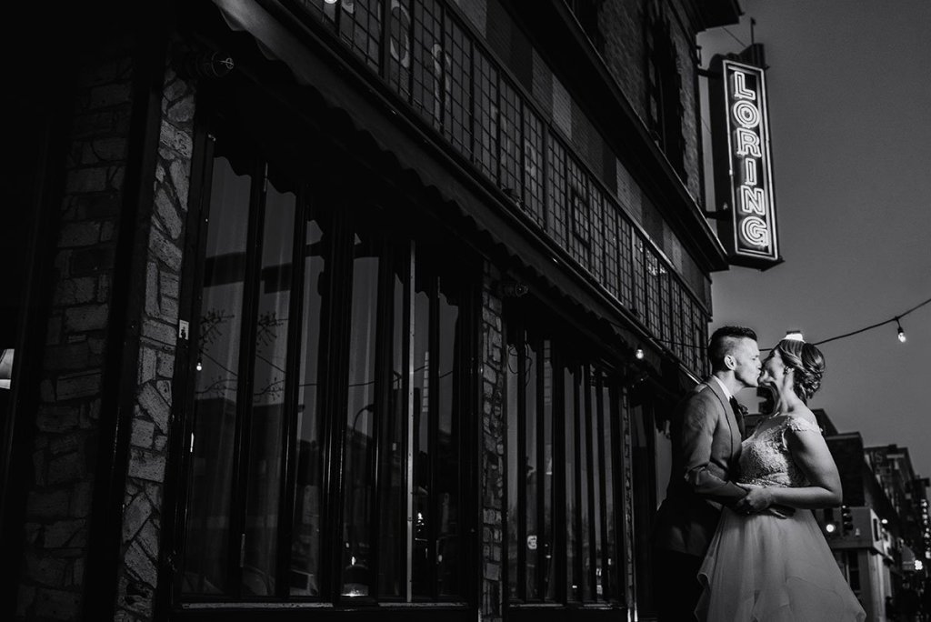 black and white portrait of couple outside loring restaurant