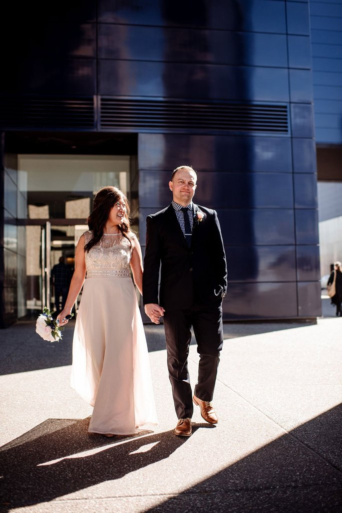 couple walks in sunlight after small wedding in minneapolis